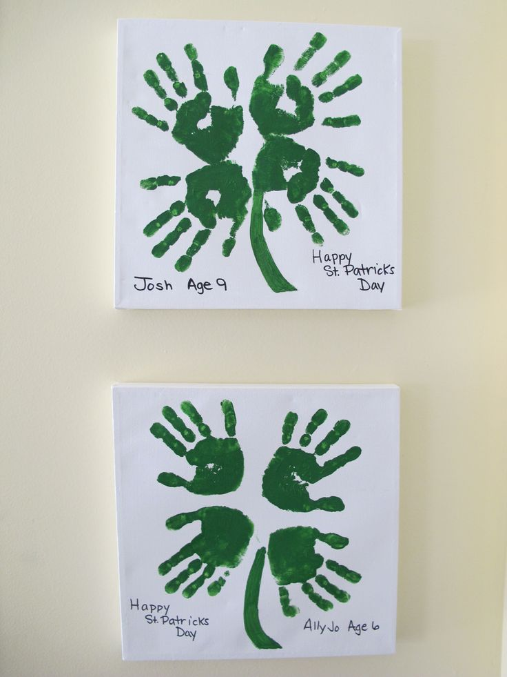 four leaf clover with hand prints