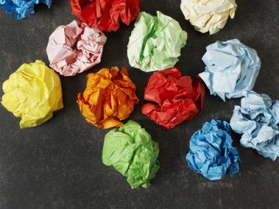 Multi-colored paper balls on black table