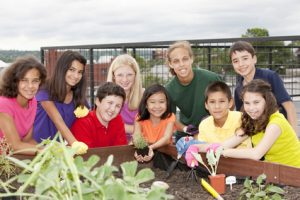 Children with a vegetable patch