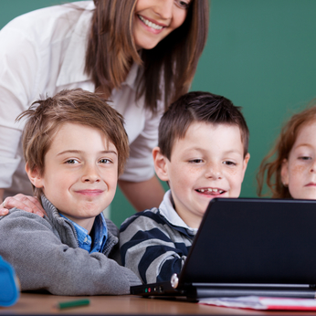 Cheerful children working with a PC